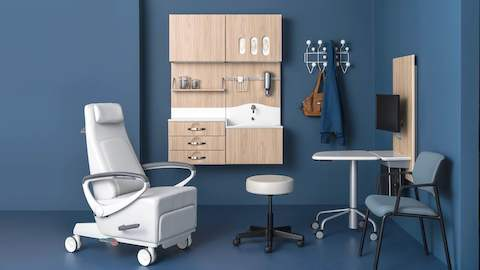 An exam room featuring a variety of products designed to foster meaningful conversation between patient and caregiver. Select to learn more about our Healthcare division.