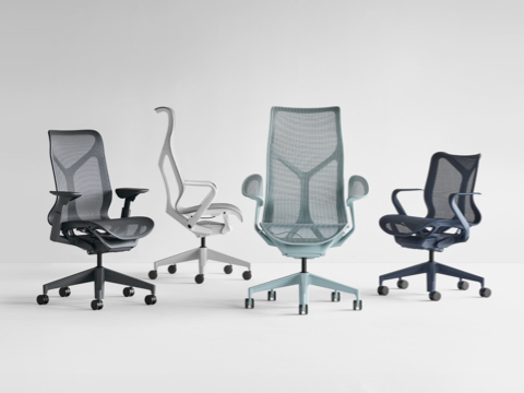 A grouping of Graphite gray, Mineral gray with white frame, Nightfall navy blue, and Glacier light blue Cosm Chairs.