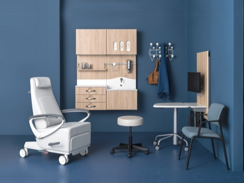 An exam room featuring a variety of products designed to foster meaningful conversation between patient and caregiver.