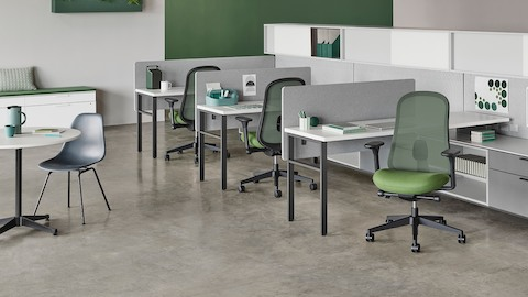Canvas Wall workstations with gray screens, upper storage, and green Lino chairs.