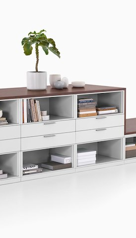 A storage unit with drawers and shelves. Select to go to the Storage product page.